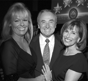 Margot Armbruster celebrates her Jack Webb Award with Chief Bratton and his talented wife, Rikki Klieman.